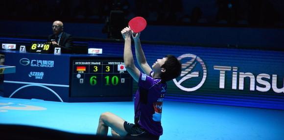 Jun Mizutani of Japan celebrates men's singles gold at the World Tour Grand Finals ©ITTF