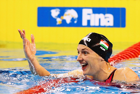 Katinka Hosszú celebrates after breaking the 100 metres backstroke world record in Doha ©Getty Images