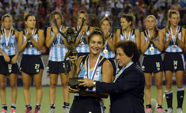 Luciana Aymar holds the Women's Champions Trophy after her last major international tournament ©Getty Images