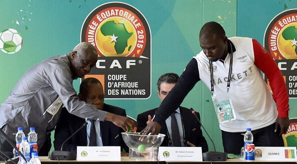 President of the Malian Football Federation Baba Diarra, CAF President Issa Hayatou, CAF secretary general Icham El Amrani and financial director of Guinea's Sports Ministry Amara Dabo take part in a draw between Mali and Guinea ©Getty Images