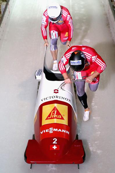 Beat Hefti and Alex Baumann secured bobsleigh victory for Switzerland ©Getty Images