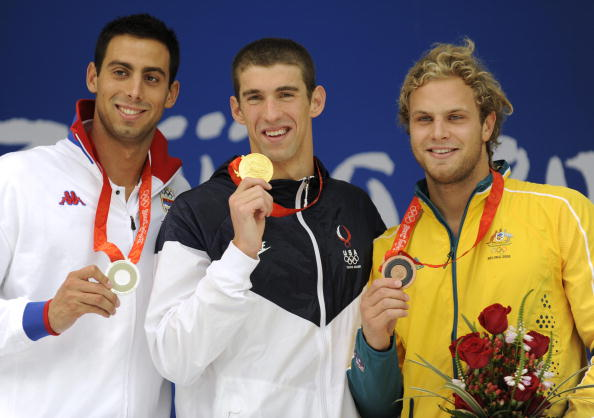 Cavic (first left) took silver in the 100 metre butterfly final in Beijing after a close battle with American Michael Phelps (centre). He retired after London 2012 following a succession of injuries ©Getty Images
