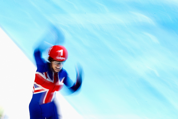 Elise Christie celebrates after crossing the line to win the second of two European gold medals today ©Getty Images