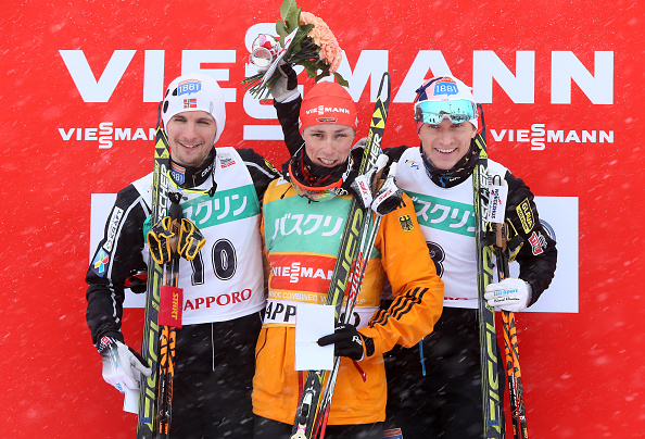 Eric Frenzel (centre) celebrates his success with second-placed Jan Schmid (left) and third-placed Haavard Klemetsen (right) ©Getty Images
