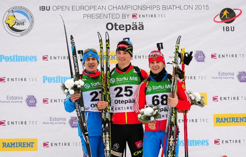 Fabien Claude (centre) celebrates his triumph in the junior men's 10 kilometre sprint at the IBU Open European Championships ©IBU