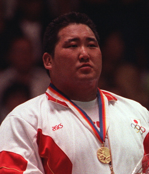 Hitoshi Saito proudly wears his gold medal after triumphing in the men's judo over 95 kilogram category at the Seoul 1988 Olympic Games ©Getty Images