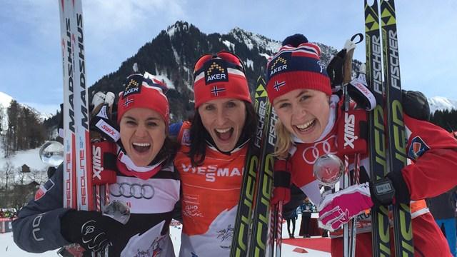 Marit Bjørgen (centre) celebrates after a Norwegian clean sweep in the prologue of the Tour de Ski ©FIS