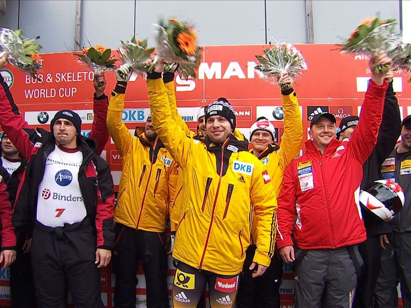 Nico Walther (centre) celebrates his first-ever World Cup victory ©FIBT