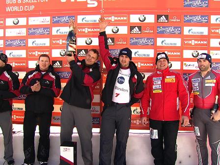 Oskars Melbardis (third from right) raises his arm in victory in St. Moritz, Switzerland ©FIBT 2015