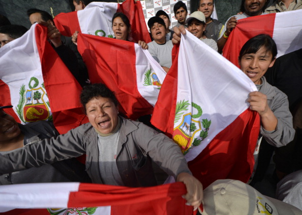Officials celebrating Lima's victory in the 2019 Pan American Games race. PASO officials will visit Peru to investigate reported problems with the bid, it has today been announced ©Getty Images