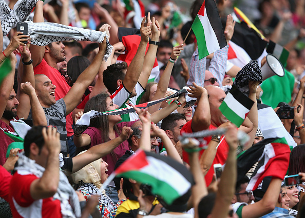 Palestine fans celebrate their first Asian Cup goal but their match ended in a 5-1 defeat ©Getty Images