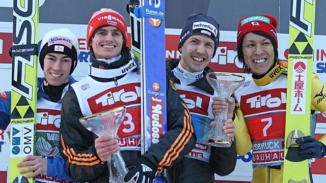 Richard Freitag (second left) celebrates with his fellow podium finishers ©FIS