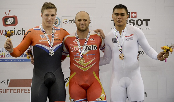Russian Denis Dmitriev (centre) beat Jeffrey Hoogland (left) and home favourite Fabian Puerta (right) in the men's sprint ©AFP/Getty Images