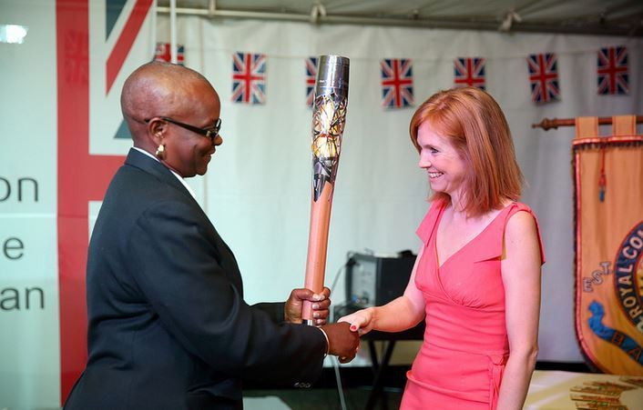Saint Lucia Olympic Committee President Fortuna Belrose, pictured (left) during the Queen's Baton Relay ahead of the Glasgow 2014 Commonwealth Games, has revealed the funding ©Glasgow 2014