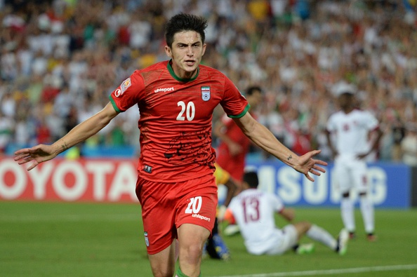 Sardar Azmoun wheels away in celebration after his winning goal ©Getty Images