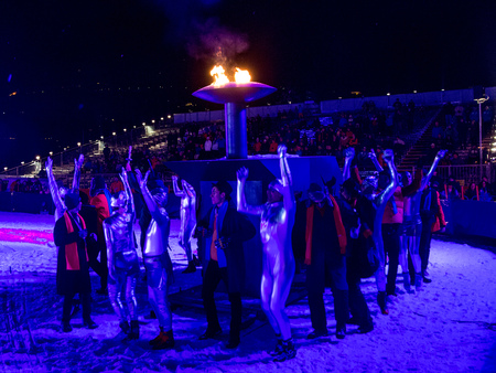 The Opening Ceremony performers at the EYOF surround the Olympic flame ©ÖOC/GEPA