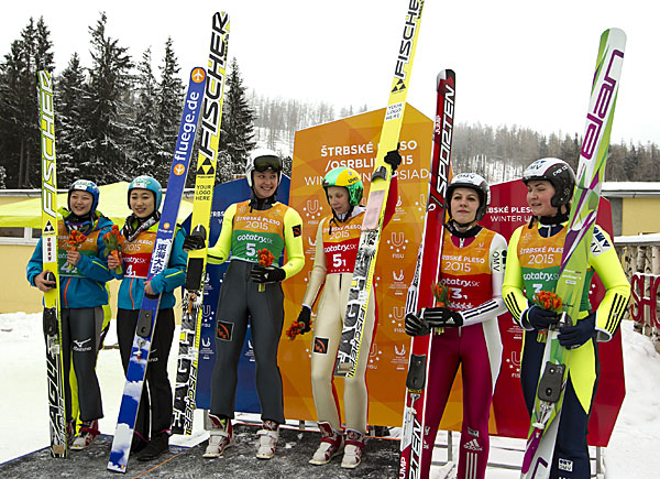 The podium of the first women's team ski jumping event in the Winter Universiade's history ©FISU