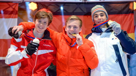 Willi Hengelhaupt (centre) won two of Germany's six gold medals, including that from today's Nordic combined boys' event ©ÖOC/GEPA