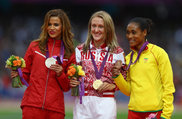 Olympic 3,000m steeplechase silver medalist Habiba Ghribi of Tunisia (left) should now receive gold following the impending disqualification of Yulia Zaripova (centre) ©Getty Images