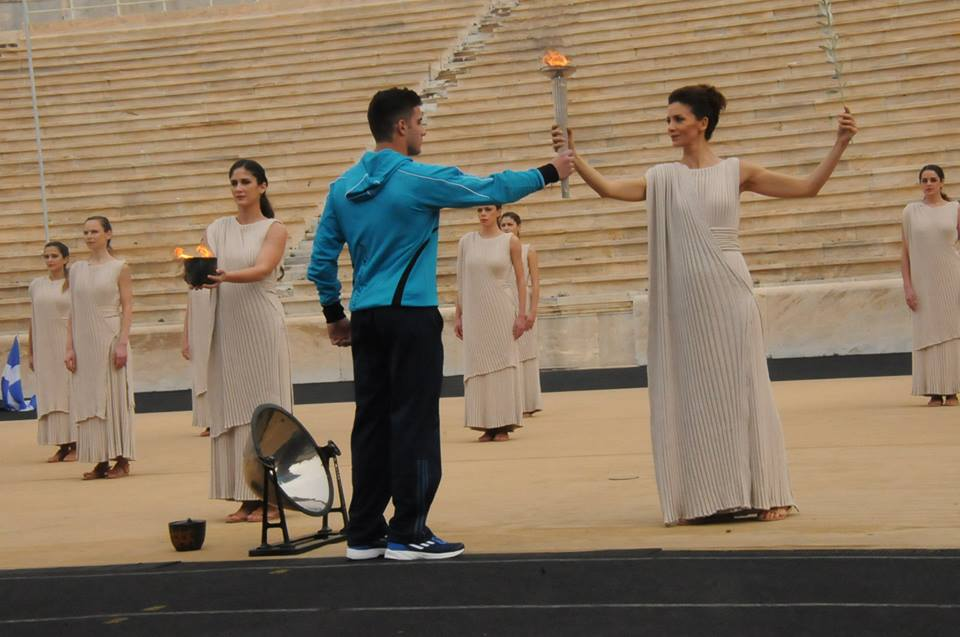 The Olympic flame is handed over to a representative of the jointly hosted Winter European Youth Olympic Festival in Athens in January ©EYOF2015