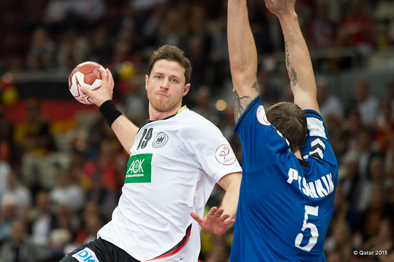 Germany on the attack against Russia in today's 27-26 win at the Qatar 2015 World Handball Championships ©Qatar2015
