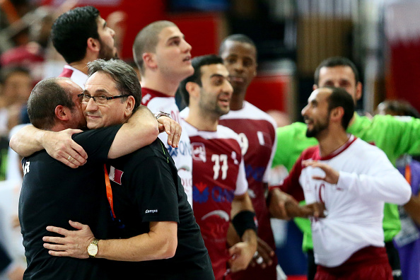 Qatar's coach Valero Rivera gets a hug as his side take in becoming the first non-European team to reach the World Handball Championships ©Getty Images