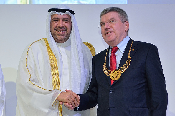 Sheikh Ahmad vowed to continue to work closely with the IOC and its President Thomas Bach, pictured receiving an ANOC Merit Award during the General Assembly ©Getty Images