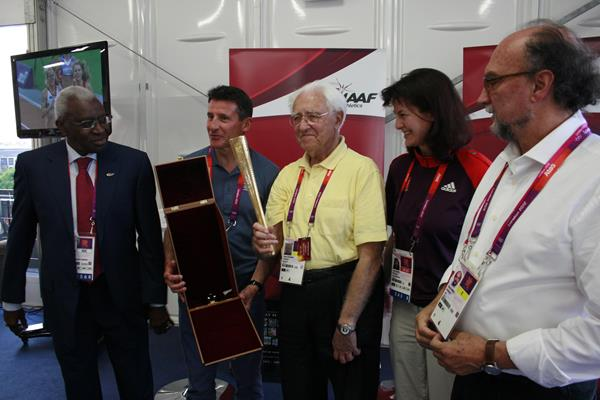Gustav Schwenk is honoured at the London 2012 Games, the 15th summer Games he covered, at a ceremony involving the IAAF President Lamine Diack (left), LOCOG Chairman Sebastian Coe (second left), London 2012 Press Operations chief Jayne Pearce and Gianni Merlo, President of the AIPS ©IAAF