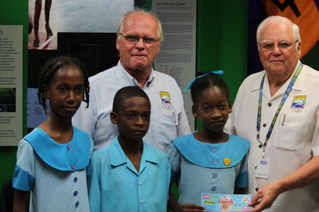 Dave Farmer, director of the National Olympic Academy of Barbados, and Steve Stoute, President of the BOA, with students of St. Lawrence Primary School at the launch of the art competition ©BOA