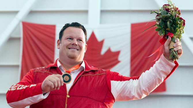 Dylan Armstrong finally received his 2008 Olympic shot put bronze medal at a ceremony attended by 700 people in his home town of Kamloops ©COC