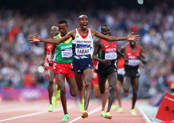 Mo Farah celebrates as he crosses the line to win the 5,000m event at London 2012 ©Getty Images