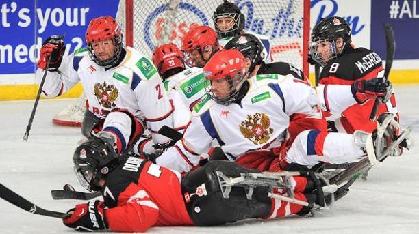 Russia and Canada clash during the semi-final showdown at the World Sledge Hockey Challenge ©Hockey Canada