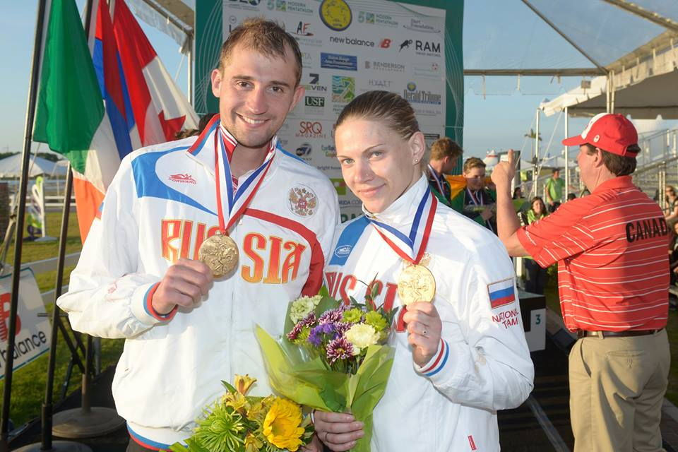 The victorious Russian pair celebrate after being awarded the gold medal ©UIPM