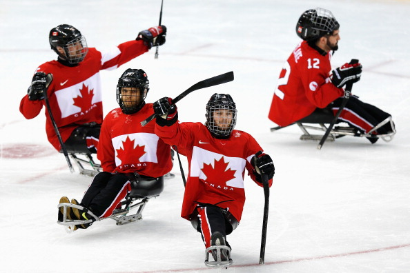 Tyler McGregor (second right) hit a double as host nation Canada beat South Korea 4-1 to claim the bronze medal ©Getty Images