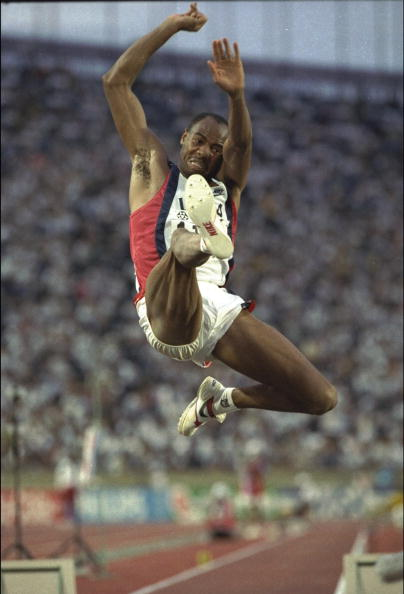 Mike Powell in flight during the 1991 Wolld Championships long jump final where he finally beat Carl Lewis, setting a world record of 8.95m ©Getty Images