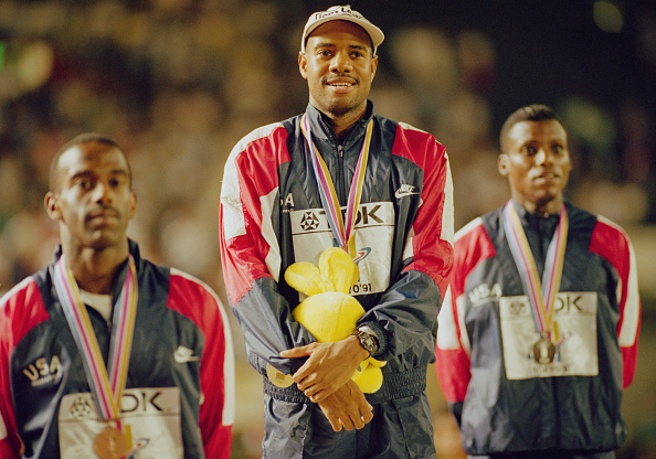Mike Powell on the podium after his 1991 world title win, flanked by Carl Lewis (right) and bronze medallist Lary Myricks ©Hulton Collection/Getty Images