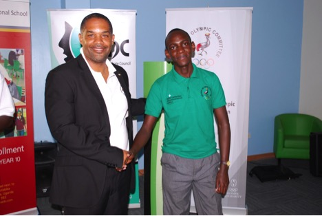 Uganda Olympic Committee President William Blick congratulates Michael Okea for securing the day's best male speaker title ©Uganda Olympic Committee