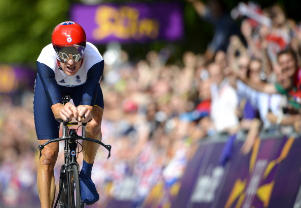 Bradley Wiggins, pictured winning gold in the time trial at the London 2012 Olympics, has set his sights on the world hour record this summer ©AFP/Getty Images