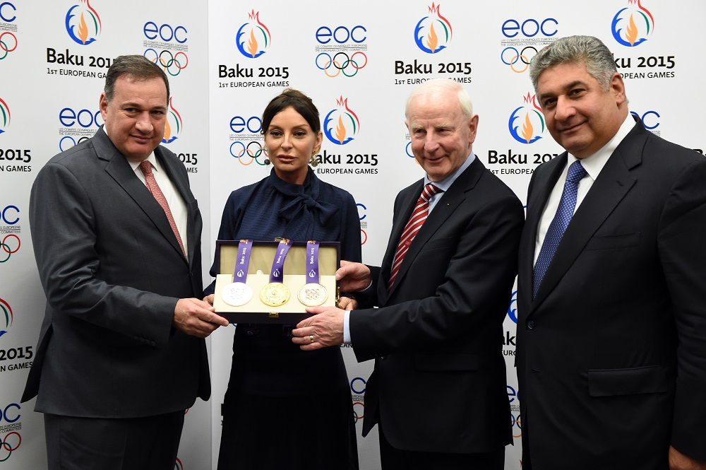 "The Baku 2015 medals will be an ""inspiration"" to athletes, claimed Azerbaijan's Minister of Youth and Sports Azad Rahimov (right), as he unveiled the design along with Patrick Hickey (second right), President of the European Olympic Committees ©Baku 2015"