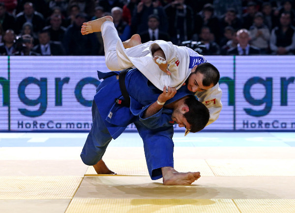 Russian Alan Khubetsov (blue) ousted home favourite Ushangi Margiani to take gold in the under 81kg category in what was a tense final ©IJF