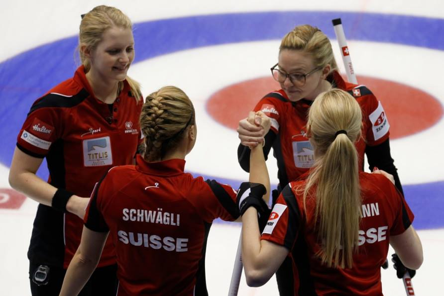 Switzerland celebrate en route to victory over Canada ©World Curling Federation/Richard Gray