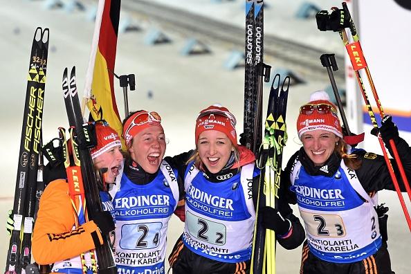 The German team of Franziska Hildebrand (left), Laura Dahlmeier (centre, left), Franziska Preuss (centre, right), and Vanessa Hinz (right) celebrate their success ©Getty Images