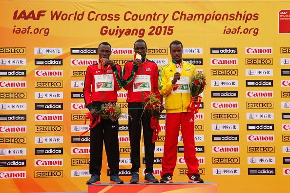 Kenya's winner Geoffrey Kamworor on the podium at the IAAF World Cross Country Championships in Guiyang ©Getty Images