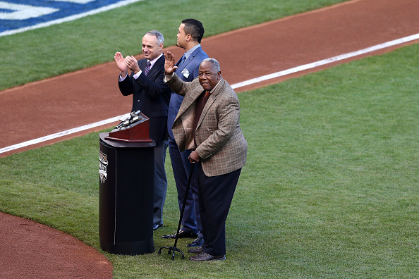Robert Manfred, pictured last year (left) with Giancarlo Stanton of Miami Marlins and Hall-of-Famer Hank Aaron (right) before the fourth World Series game, has paid tribute to the leadership skills imbued in him at Cornell University under the tutorship of Professor Bacharach ©Getty Images
