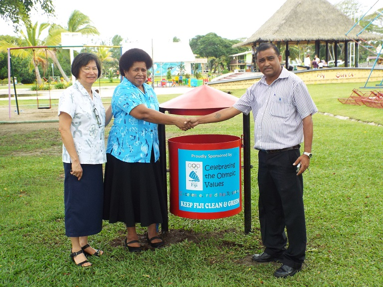 Lorraine Mar and Makarita Lenoa donate the bins to Naresh Narayan in Suva ©FASANOC