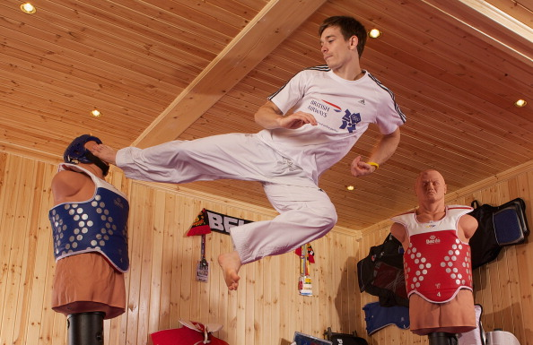 Taekwondo star Aaron Cook practising in his home-made gym in 2011, with his mind on the London 2012 Games. He now has his sights on the Rio 2016 Games - and he has a Moldovan passport  ©Getty Images for British Airways