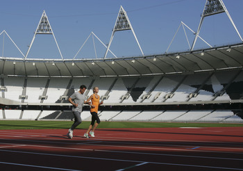 Olympic stadium_first_lap_with_Sebastian_Coe_and_Hannah_England_October_3_2011