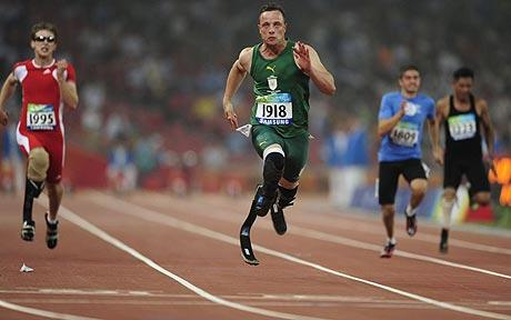 Oscar Pistorius crossing the line ahead of rivals