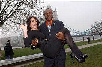 Carl_Lewis_with_Nadia_Comenaci_London_2012_ticket_launch_March_15_2011