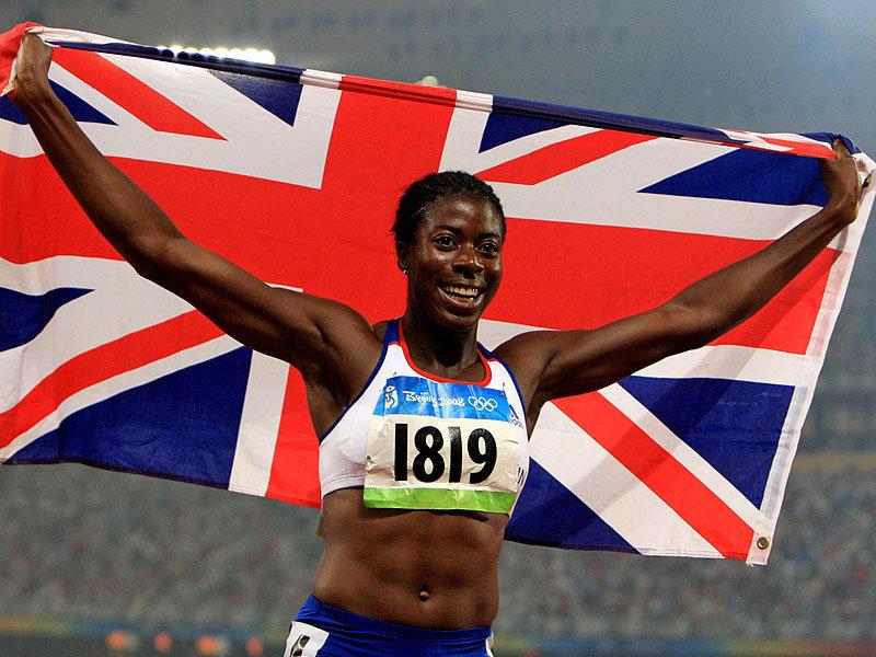 Christine_Ohuruogu_waving_flag_in_Beijing